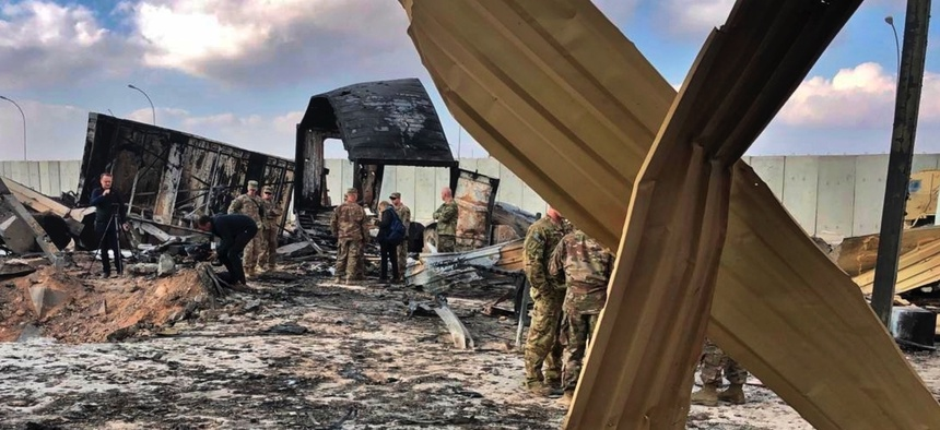 U.S. soldiers and journalists inspect the rubble at a site of Iranian bombing, in Ain al-Asad air base, Anbar, Iraq, Monday, Jan. 13, 2020.