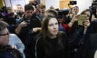 Alla Ilyina, who broke out of a Russian hospital on Feb. 7 after learning that she would have to spend 14 days in isolation instead of the 24 hours doctors promised her, speaks to the media in a courtroom in St. Petersburg, Russia, on Feb. 17, 2020.