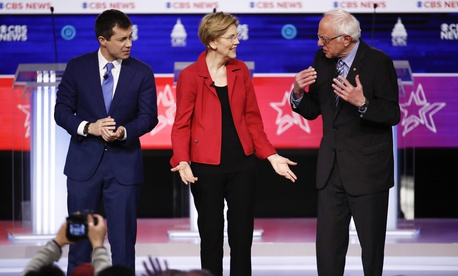 From left, former South Bend Mayor Pete Buttigieg, Sen. Elizabeth Warren, D-Mass., and Sen. Bernie Sanders, I-Vt., on stage as they participate in a Democratic presidential primary debate at the Gaillard Center, Tuesday, Feb. 25, 2020, in Charleston, S.C.