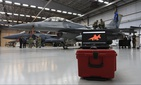 A completed 3-D scan of a F-16C Fighting Falcon is displayed on a screen as technicians maintain at Nellis Air Force Base, Nevada, Feb. 11, 2020. Operators looked to recreate the jet using virtual reality