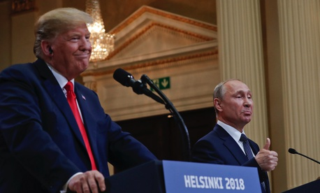 Russian President Vladimir Putin, right, and U.S. President Donald Trump give a joint news conference at the Presidential Palace in Helsinki, Finland, on Monday, July 16, 2018.