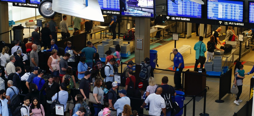 In this June 9, 2019, file photo, travelers make their way through a TSA security checkpoint in Pittsburgh International's Landside terminal in Imperial, Pa.