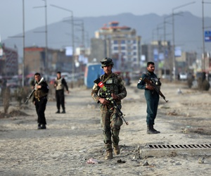 Afghan security personnel gather at the site of bomb explosion in Kabul, Afghanistan, Wednesday, Feb. 26, 2020.