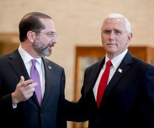 Vice President Mike Pence (right) and Health and Human Services Secretary Alex Azar speak as Pence arrives for a coronavirus task force meeting at HHS on Thursday.