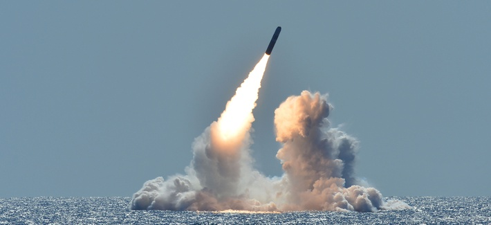 An unarmed Trident II D5 missile launches from the Ohio-class ballistic missile submarine USS Nebraska off the coast of California.