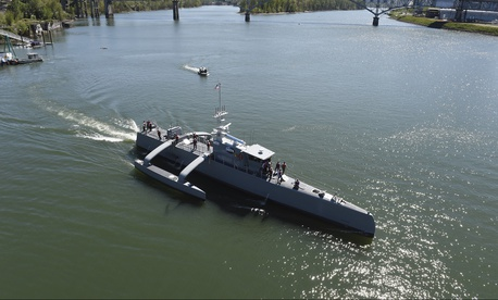 Sea Hunter, a class of unmanned ocean-going vessel gets underway on the Willamette River following a christening ceremony in Portland, Ore., April 7, 2016