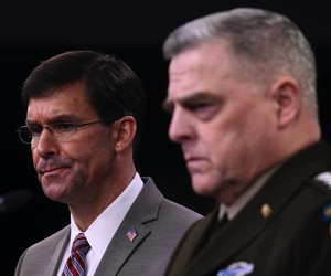 Defense Secretary Mark Esper, left, and Chairman of the Joint Chiefs of Staff Army Gen. Mark Milley, right, during a briefing at the Pentagon in Washington, Monday, March 2, 2020.