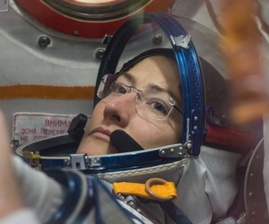 At the Baikonur Cosmodrome in Kazakhstan, NASA astronaut Christina Koch works inside the Soyuz MS-12 spacecraft Feb. 27 during pre-launch training.