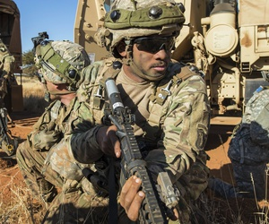 Army Pfc. Cameron Livingston, center, provides security as soldiers move a disabled vehicle as part of an attack scenario during the Shared Accord exercise at the South African Army Combat Training Center in Lohatla, South Africa, July 27, 2017.