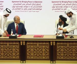 U.S. peace envoy Zalmay Khalilzad, left, and Mullah Abdul Ghani Baradar, the Taliban group's top political leader sign a peace agreement between Taliban and U.S. officials in Doha, Qatar, Saturday, Feb. 29, 2020.