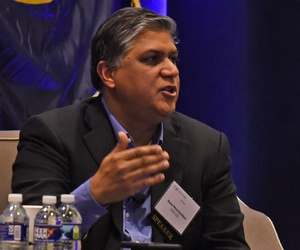 Nand Mulchandani, chief technology officer, Joint Artificial Intelligence Center, speaks Dec. 12, 2019, at the AFCEA NOVA-sponsored 18th Annual Air Force Information Technology Day in Washington