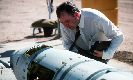 A Soviet inspector examines a BGM-109G Tomahawk ground launched cruise missile (GLCM) before its destruction in 1988.