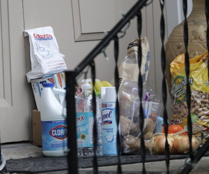 Groceries, cleaning supplies, prescription medicine, and other items are shown on the porch of a couple in Kirkland, Washington, who are in quarantine because  they visited patients at a nursing home that has been central to the coronavirus outbreak.