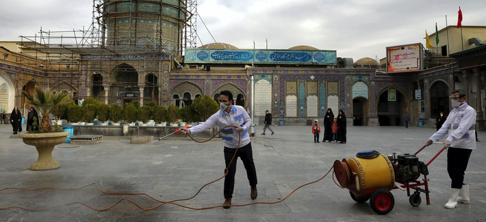 Workers disinfect the shrine of the Shiite Saint Imam Abdulazim to help prevent the spread of the new coronavirus in Shahr-e-Ray, south of Tehran, Iran, Saturday, March, 7, 2020.