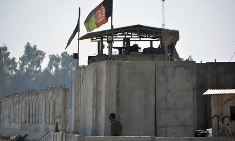 An Afghan security personnel stand guard in the checkpoint of airport after a suicide attack in Jalalabad province, east of Kabul, Afghanistan, Wednesday, March 6, 2019. Militants in Afghanistan set off a suicide blast.