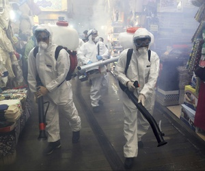 Firefighters disinfect a traditional shopping center to help prevent the spread of the new coronavirus in northern Tehran, Iran, Friday, March, 6, 2020.