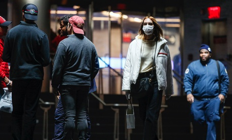 A commuter wears a face mask in the New York City transit system, Monday, March 9, 2020, in New York. New York continued grappling Monday with the new coronavirus, as case numbers, school closings and other consequences grew.