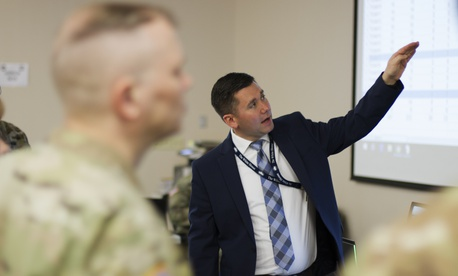 SAIC employee DJ Hovermale explains the network system used during Cyber Shield 19 at Camp Atterbury, Ind., April 16, 2019.