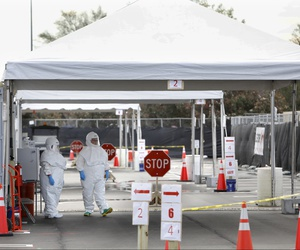 Medical University of South Carolina healthcare providers dress in protective suiting as they get ready to see patients by the hospital's drive-through tent for COVID-19 Testing on March, 13, 2020.l