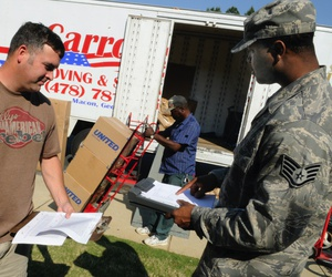 TSgt. Chris Altham, 339th Flight Test Squadron aircrew flight equipment, confers with SSgt. Clarence Lee, 78th Logistic Readiness Squadron quality control inspector about the moving of his household goods.
