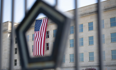 An American flag hangs over the Pentagon, Sept. 11, 2019, on the anniversary of the 9/11 attacks.