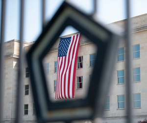An American flag, unfurled at dawn, hangs over the Pentagon on the anniversary of the 9/11 attacks on Sept. 11, 2019.