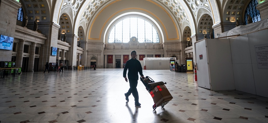 Washington Union Station, a major transportation hub in the nation's capital, is nearly empty during morning rush hour as many government and private sector workers stay home during the coronavirus outbreak, in Washington, Monday, March 16, 2020.