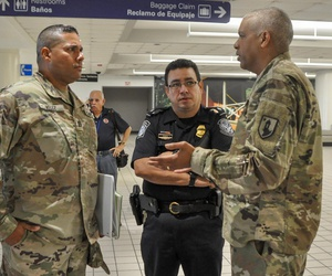 Puerto Rico National Guard and local law enforcement helped establish the action plan to be taken with passengers arriving at Luis Muñoz Marín International Airport in Carolina, Puerto Rico, to detect any suspected cases of COVID-19, March 16.