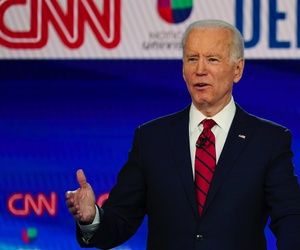 In this Sunday, March 15, 2020, photo, former Vice President Joe Biden, with Sen. Bernie Sanders, I-Vt., speaks during a Democratic presidential primary debate at CNN Studios in Washington.