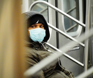 A man wears a mask on the New York subway on Monday.