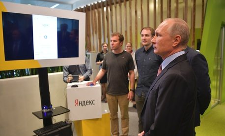 Russian President Vladimir Putin, right, visit Russia's largest internet search engine Yandex headquarters in Moscow, Russia, Thursday, Sept. 21, 2017