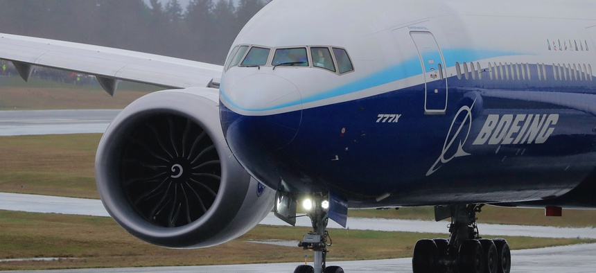 A Boeing 777X airplane leaves the company's Everett, Washington, factory on Jan. 24, 2020. Company officials announced that several plants will suspend operations for public-health reasons.