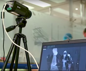 A screenshot from a video by Emirates Airlines showing the use of FLIR thermal cameras for passenger screening.