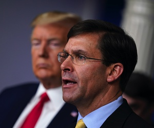 Defense Secretary Mark Esper speaks as President Donald Trump listens during press briefing with the Coronavirus Task Force, at the White House, Wednesday, March 18, 2020, in Washington.