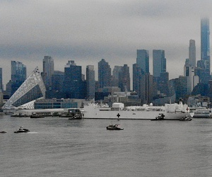 The Navy hospital ship USNS Comfort passes the Manhattan skyline on its way to docking in New York. The ship has 1,000 beds and 12 operating rooms that could be up and running within 24 hours of its arrival on Monday morning.