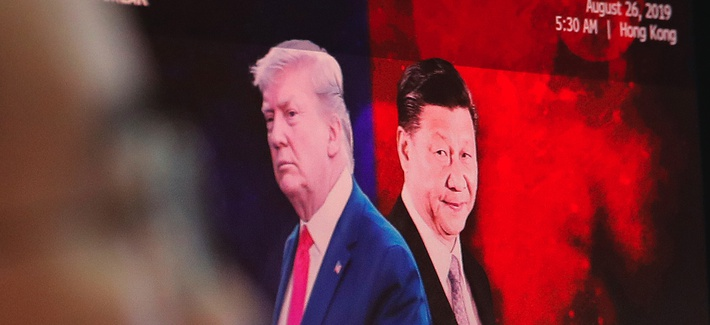 2019 photo of a computer screen in a South Korean trading floor bearing images of Chinese President Xi Jinping, right, and U.S. President Donald Trump