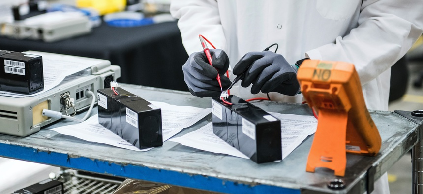 An engineer tests voltage of new batteries at Bloom Energy in Sunnyvale, Calif., a fuel cell generator company that has switched over to refurbishing ventilators.