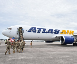 Soldiers from 2nd Armored Brigade Combat Team, 3rd Infantry Division board an Atlas Air plane at Hunter Army Airfield, Ga., March 3.