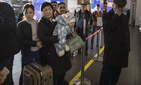 Kyrgyzstan's people queue up to board a plane to Osh, Kyrgyzstan at the Zhukovsky international airport 36 km (22,5 mikes) southeast of Moscow, Russia, Monday, March 23, 2020.