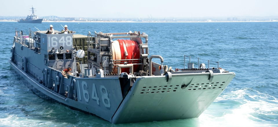 Landing Craft, Utility (LCU) 1648, attached to Assault Craft Unit (ACU) 1, prepares to enter the well deck of the dock landing ship USS Comstock (LSD 45).