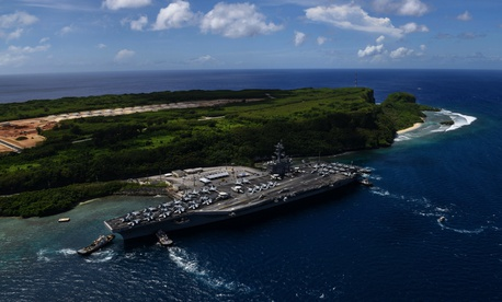 This 2017 photo shows the USS Theodore Roosevelt leaving the pier at Naval Base Guam.