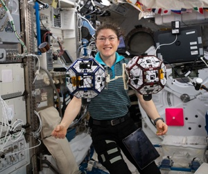 Expedition 60 Flight Engineer Christina Koch of NASA can be seen here floating with the SPHERES robots in July.