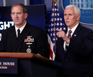Navy Rear Adm. John Polowczyk, supply chain task force lead at FEMA, and Vice President Mike Pence speak about the coronavirus in the James Brady Press Briefing Room of the White House on Thursday.