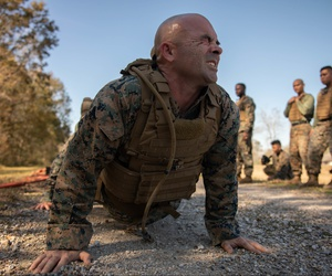Staff Sgt. Matthew Driggers, fleet readiness center senior enlisted advisor with Marine Light Attack Helicopter Squadron 773, Marine Aircraft Group 49, executes a pushup during Martial Arts Instructor Course 1-20 aboard Naval Air Station Joint Reserve Bas