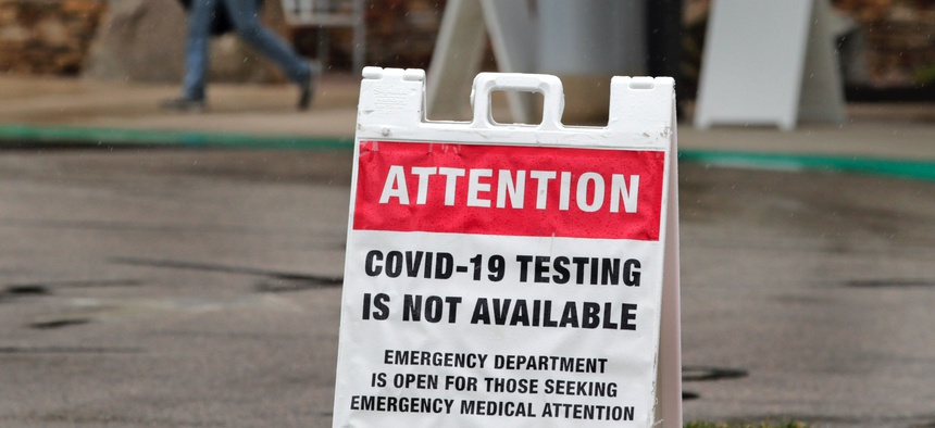 A sign alerting the public that COVID-19 testing is not available is posted outside the entrance to the Exeter Hospital Exeter, N.H., Thursday, April 9, 2020.
