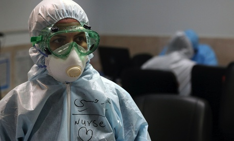 A nurse wears protective gear in a ward dedicated for people infected with the new coronavirus, at a hospital in Tehran, Iran, Sunday, March 8, 2020.
