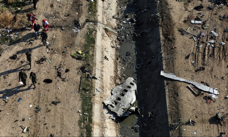 In this Wednesday, Jan. 8, 2020 file photo, rescue workers search the scene where a Ukrainian plane crashed in Shahedshahr, southwest of the capital Tehran, Iran.