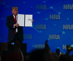 President Donald Trump holds up a letter to the Senate about the UN Arms Trade Treaty as he speaks to the annual meeting of the National Rifle Association, Friday, April 26, 2019, in Indianapolis.