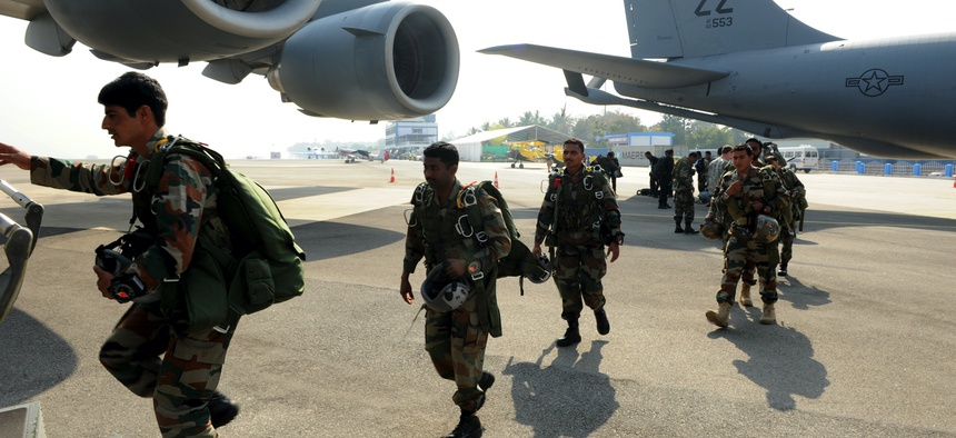 Soldiers of the U.S. Army's 1st Special Forces Group and India's 2nd Parachute Regiment (Special Forces) and National Security Guard load into a Pacific Air Forces C-17 Globemaster III for a parachuting demonstration at Bengaluru, India, in 2015.
