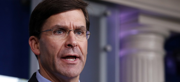 Defense Secretary Mark Esper speaks about the coronavirus in Washington.